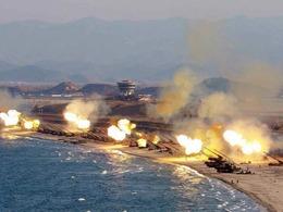 金正恩指导朝鲜最大规模炮击演练[图]
